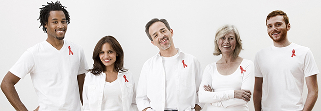 Group of people with red ribbons. © Image Source Photography/Veer